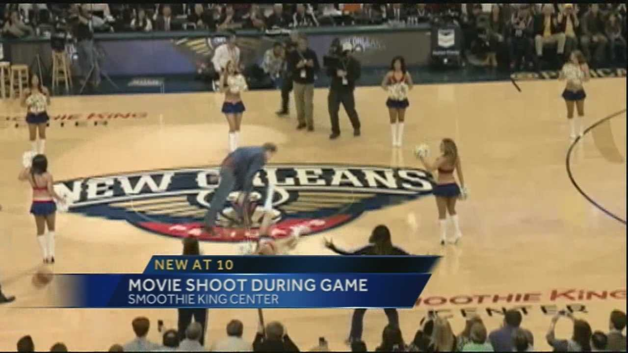 Actors Will Ferrell and Mark Wahlberg attended the New Orleans Pelicans backetball game for a movie shoot. As part of the shoot, Ferrell launches a ball at an actress playing a cheerleader during halftime.