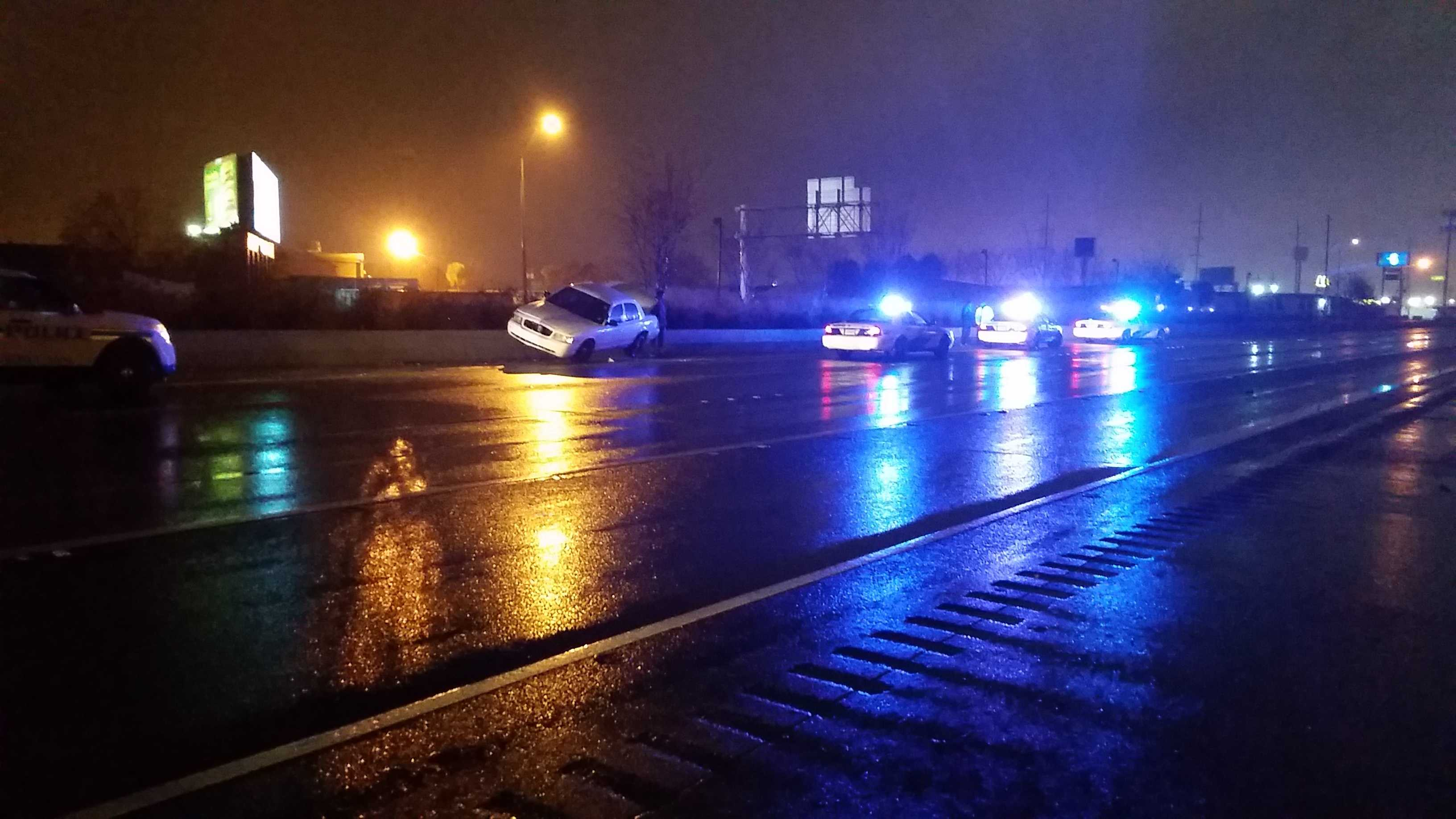 A New Orleans Police Department vehicle strikes a guardrail on Interstate 10 early Friday morning.