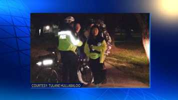 Tulane University Police Department officer stops and questions two students believed to be responsible for theft of letter from Loyola University front lawn. Officers confiscated the letter.