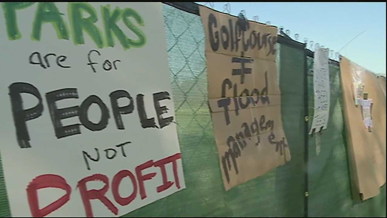 More than 100 people gathered at City Park on Saturday afternoon to protest a $24.5 million golf course.