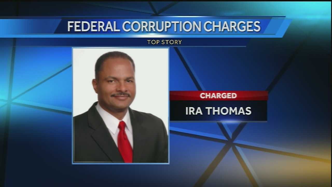 A New Orleans school board member faces a federal charge in an alleged bribery scheme.