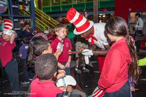 """WDSU anchor Adrianna Hopkins and New Orleans Saints cornerback Keenan Lewis read Dr. Suess' """"Green Eggs and Ham"""" to children at the New Orleans Children's Museum. The reading was part of field trip brought to the children by Winn-Dixie, which teamed up with Lewis and musician Amanda Shaw."""