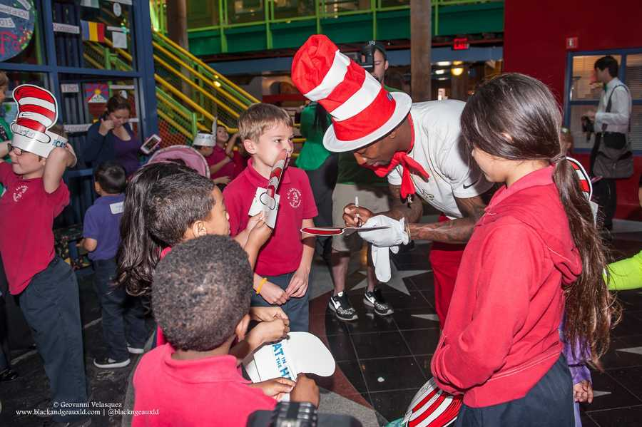 "WDSU anchor Adrianna Hopkins and New Orleans Saints cornerback Keenan Lewis read Dr. Suess' ""Green Eggs and Ham"" to children at the New Orleans Children's Museum. The reading was part of field trip brought to the children by Winn-Dixie, which teamed up with Lewis and musician Amanda Shaw."