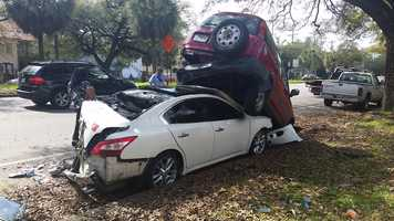 An 18-year-old man suffered two broken legs after he was pinned between two parked cars in a crash Friday morning in New Orleans, police said.