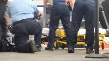 Responders tend to the scene following a shooting at Armstrong International Airport.