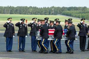 Maj. Gen. Glenn H. Curtis, adjutant general of the Louisiana National Guard, and other senior leaders honor fallen Army Chief Warrant Officer 4 George David Strother during a deplaning ceremony at the LANG's Army Aviation Support Facility #2 at Esler Air Field in Pineville, La., March 24, 2015. Strother was killed along with three other Guardsmen and seven Marines in a UH-60M Black Hawk crash in the Santa Rosa Sound, Navarre, Florida, March 10, 2015.