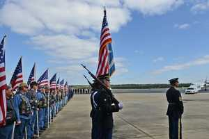 The Louisiana National Guard Color Guard, law enforcement officers and Patriot Guard Riders honor fallen Army Chief Warrant Officer 4 George David Strother during a deplaning ceremony.