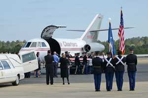 The Louisiana National Guard honors fallen Army Chief Warrant Officer 4 George David Strother during a deplaning ceremony.