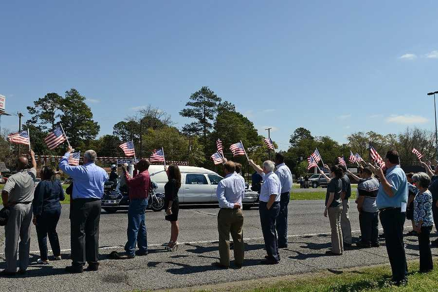 The communities of Central Louisiana came together to show their support along MacArthur Drive in Alexandria, La., to honor fallen Army Chief Warrant Officer 4 George David Strother of Pineville, La.