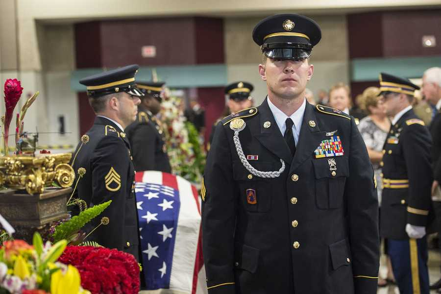 Members of the Louisiana National Guard conduct a 'changing of the guard' ritual while guarding fallen Soldier Chief Warrant Officer 4 George David Strother at the Alexandria Riverfront Convention Center in Alexandria, La.