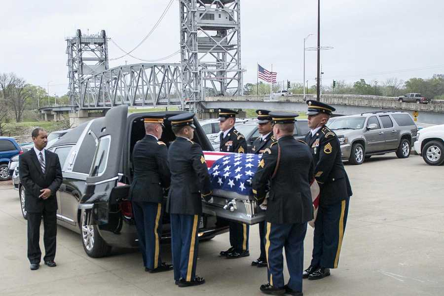 Members of the Louisiana National Guard's military funeral honors team move fallen Soldier Chief Warrant Officer 4 George David Strother at the Alexandria Riverfront Convention Center in Alexandria, La.