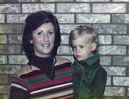 A young Scott Walker being held by his mother.