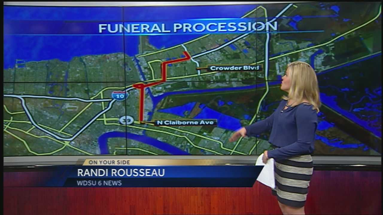 Ramdi Rousseau goes over the funeral procession route for NOPD Officer Daryle Holloway.