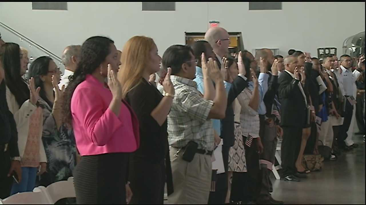 Fifty people became U.S. citizens in a naturalization ceremony at the National World War II Museum in New Orleans.