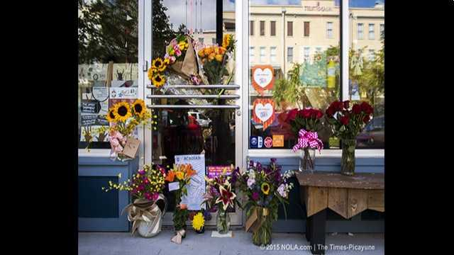 Flowers lay in front of Red Arrow Workshop, the shop owned by #LafayetteShooting victim Jillian Johnson