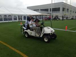 Saints owners Tom and Gayle Benson on the field before practice.