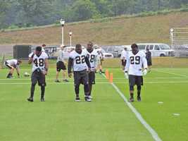Saints runningbacks after team drills.