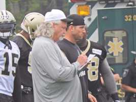 Coach Rob Ryan looking over the playbook during team drills.