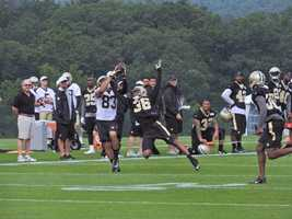 Receiver Willie Snead and cornerback P.J. Williams battle for the ball.
