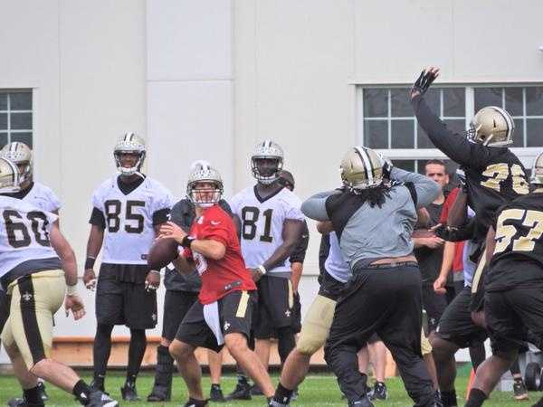 Quarterback Drew Brees looks for an open receiver.