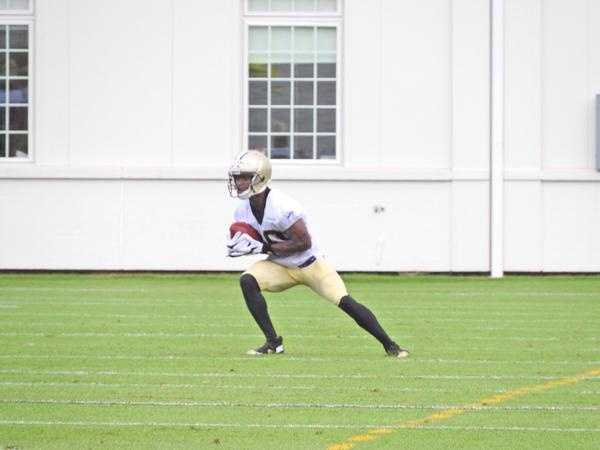 Receiver Brandin Cooks catches a punt during team drills.