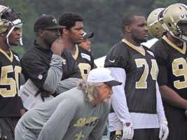 Coach Rob Ryan and the defense watching the teams scrimmage.