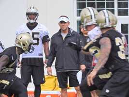 Coach Sean Payton looks over the team during one on one drills.