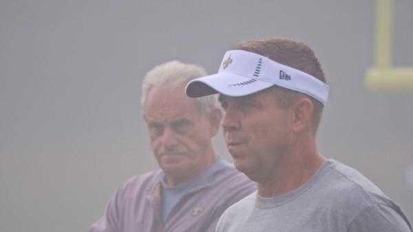 Saints coaches Sean Payton and Joe Vitt watching over the team.