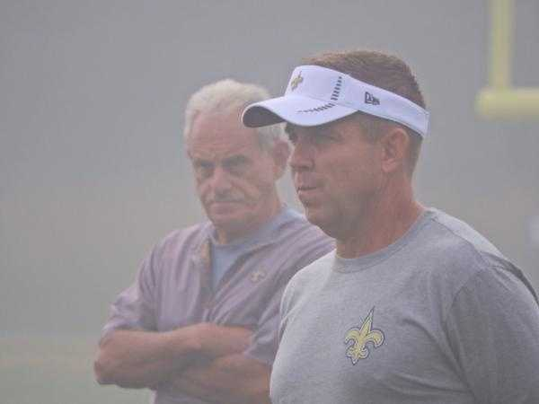 Saints coaches Sean Payton and Joe Vitt watching over the team.