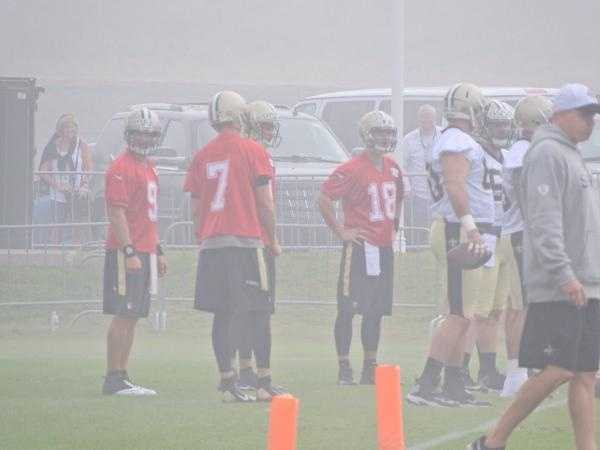Saints quarterbacks during team drills.