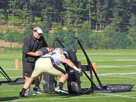 Saints offensive lineman working on the sled.
