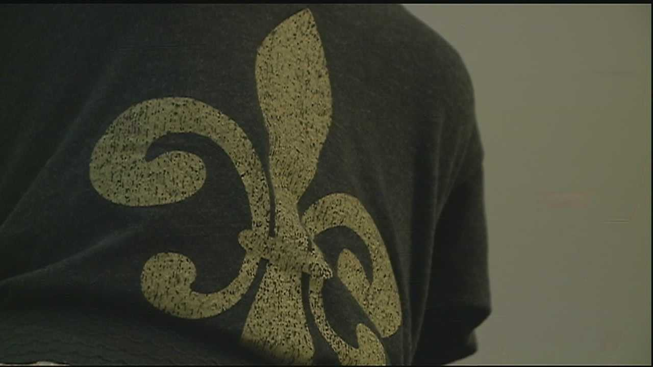 A SYMBOL OF NEW ORLEANS... UNDER ATTACK. OR IS IT?      A FRENCH QUARTER BUSINESS RECEIVED A LETTER -- APPEARING TO BE FROM THE MAYOR'S OFFICE-- DENOUNCING THE FLEURDELIS.       THE LETTER RECOMMENDS THE BUSINESS STOP SELLING FLEUR DE LIS MERCHANDISE BECAUSE OF ITS CONNECTION TO SLAVERY.       BUT THE LETTER... IS A FAKE.