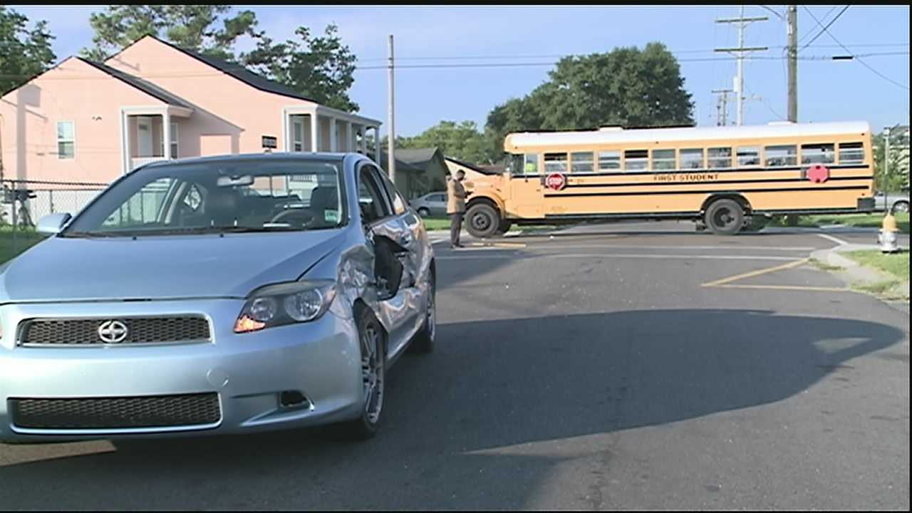 A car was hit by a school bus in the Hollygrove neighborhood Tuesday morning, New Orleans police said.