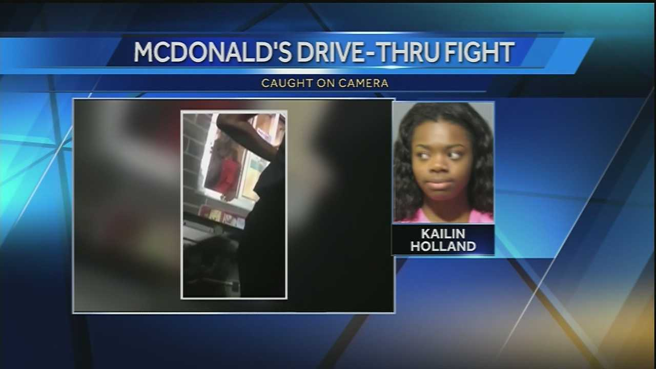 Four people were arrested for their roles in the battery of a 16-year-old girl who was pulled through a drive through window and punched several times, authorities said.