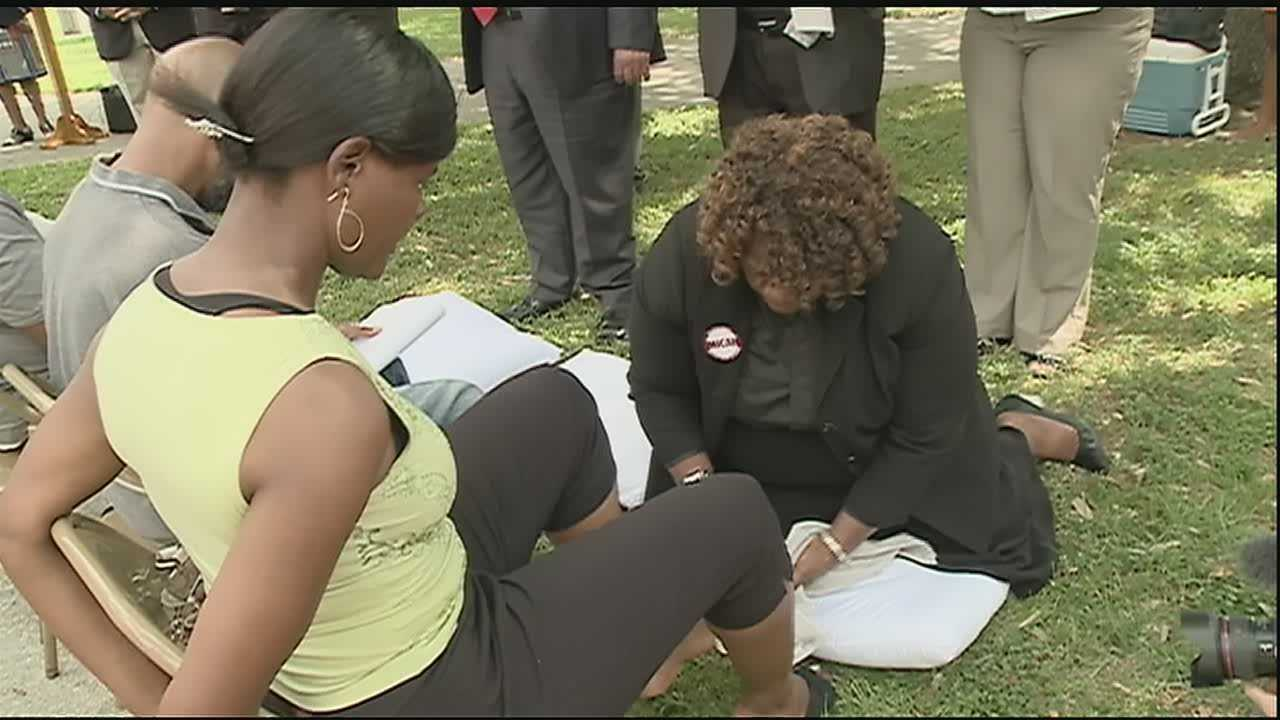 A group of multiracial clergy and community leaders came together Thursday morning to spread a message of inclusion through the act of washing feet.
