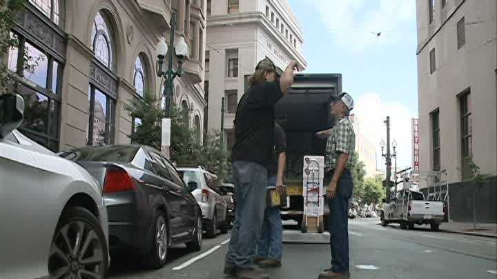The corner of Common and Carondelet streets was buzzing Tuesday with news that a massive beehive there is being moved.
