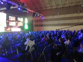 Crowds cheer, wear team gear, and applaud the athletes as they play Call of Duty.