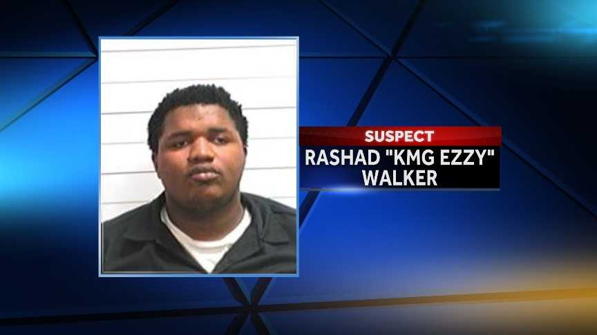 "Rashad ""KMG EZZY"" Walker, 22, was identified as a suspect on Dec. 4. He remains at-large on 17 counts of attempted first-degree murder."