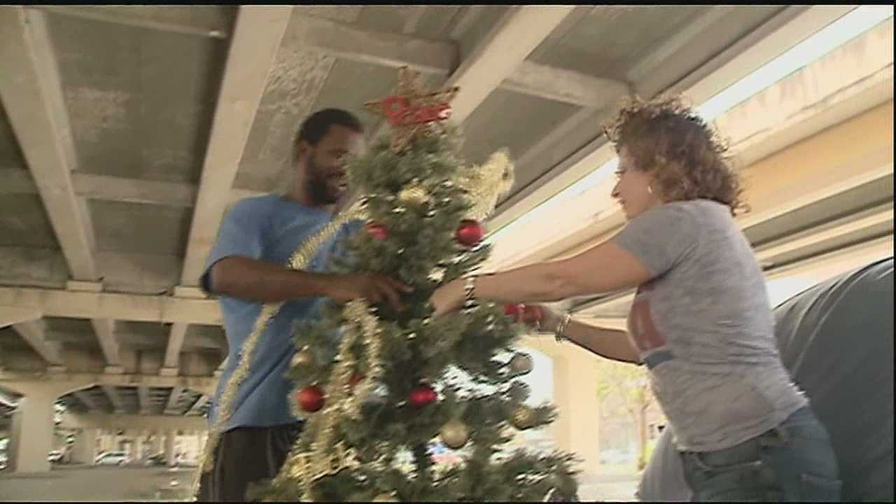 A day after city workers removed his Christmas tree, a homeless man and his friends living under the Pontchartrain Expressway have their holiday spirit once more.