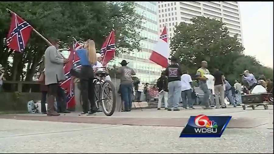 Dec. 10, 2015: City Council holds special session, a Committee of the Whole, to allow public to discuss the removal of monuments one last time. Outside City Hall, a handful of people held Confederate flags in support of the statues while a larger group gathered next to them and held signs demanding removal.