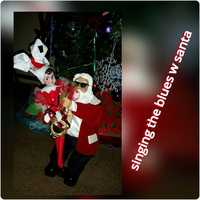 "April H. Young: ""Singing the blues w Santa."""