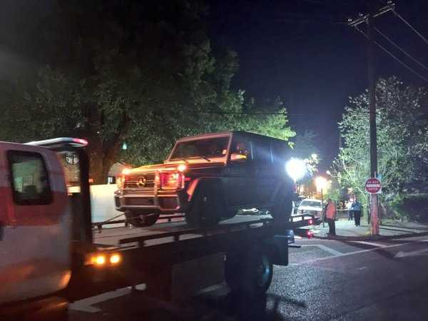 Smith's vehicle being towed away from the shooting scene.