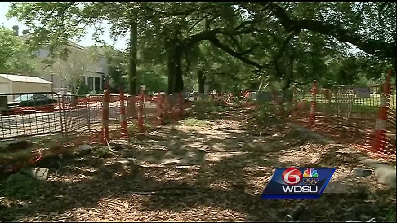 An open drainage canal, 8 feet deep and half a city block long, has been left exposed behind barricades in a Camp Street park for more than a year.