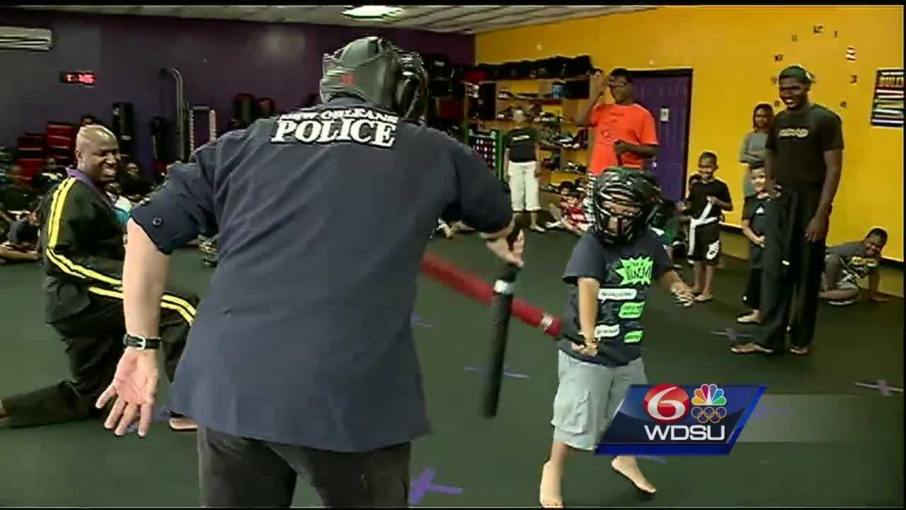 "New Orleans police officers take time out to ""kick it"" with children in an effort to ""cut"" crime."