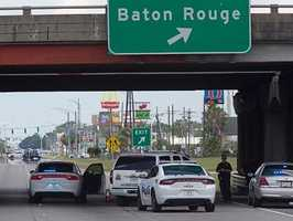 Three or four officers are feared dead after multiple suspects opened fire on them in Baton Rouge, Louisiana, on Sunday officials said.