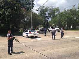 Baton Rouge police officers manned a roadblock at Old Hammond Highway and Tara Boulevard after multiple officers were shot.