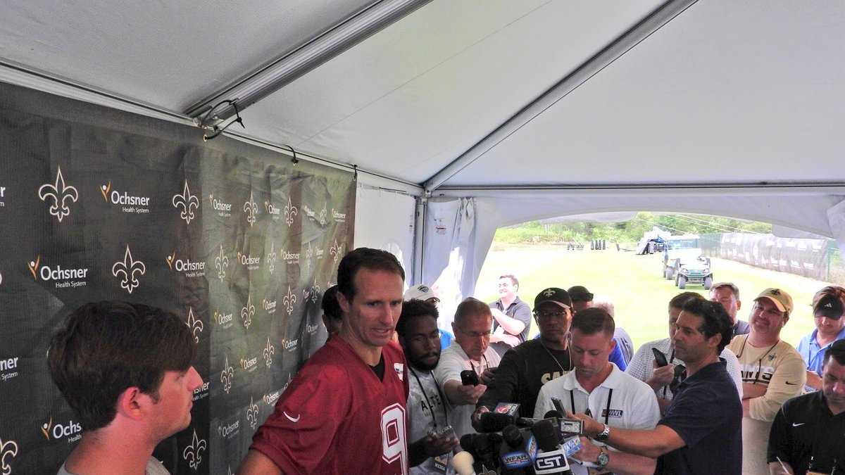 Drew Brees speaks to the media following the first full day of practice at training camp in White Sulphur Springs, West Virginia.