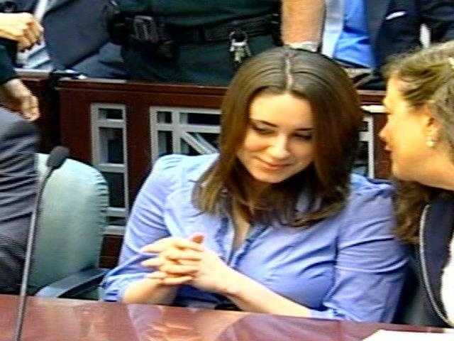 Casey Anthony, left, in court on Thursday meeting her new death penalty attorney, Andrea Lyon.