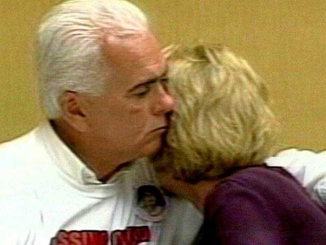 George Anthony is hugging his wife Cindy Anthony.