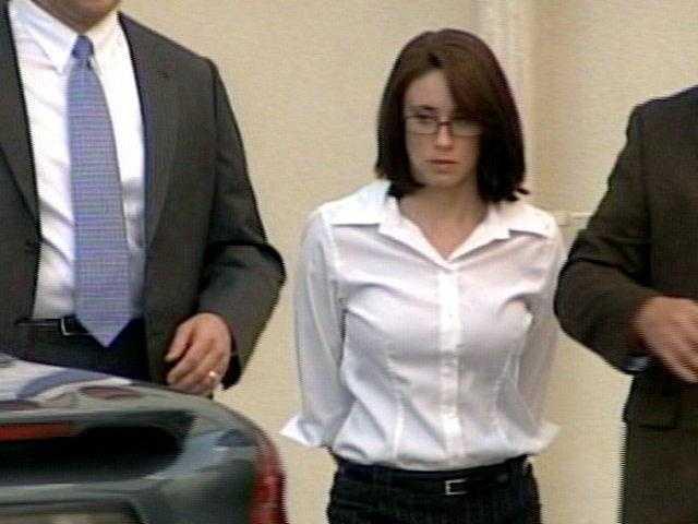 Casey taken to jail dressed up